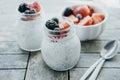 Two small jars of  chia pudding, yogurt and fresh fruits: Strawb Royalty Free Stock Photo