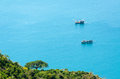 Two small wooden fishing boats fishing on the sea, Nam Du Island Royalty Free Stock Photo