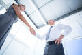 Two smiling business people shaking hands low angle view of Stock Images
