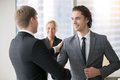 Two smiling businessmen handshaking Royalty Free Stock Photo