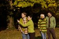 Two Couples In Autumn Park