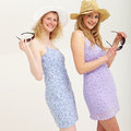 Two smiling friends in summer outfits Royalty Free Stock Photo