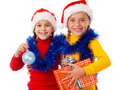 Two smiling girls with Christmas decoration Stock Image