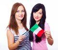 Two smiling girls holding flag of italy a closeup young isolated on white Royalty Free Stock Photo