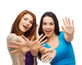 Two smiling girls showing their palms happiness and people concept Stock Photo