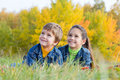 Two Smiling Kids On The Autumn...