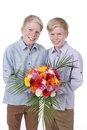 Two smiling kids with flowers isolated Stock Photography