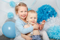 two smiling laughing hugging cute adorable Caucasian children, toddler girl and baby boy, celebrating birthday Royalty Free Stock Photo