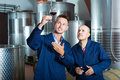 Two smiling men coworkers wearing uniform standing with glass of Royalty Free Stock Photo
