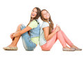 Two smiling teenage girls isolated on white background friends Royalty Free Stock Image