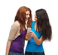 Two smiling teenagers with smartphone technology friendship and people concept Stock Images
