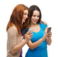 Two smiling teenagers with smartphones technology friendship and people concept Stock Image