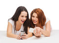 Two smiling teenagers with smartphones technology friendship and people concept Royalty Free Stock Image