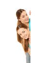 Two smiling women holding white blank poster Royalty Free Stock Photo