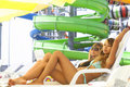 Two smiling women relaxing on deckchair Royalty Free Stock Photos