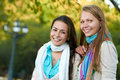 Two smiling young girls outdoors Stock Photo