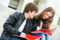 Two smiling young students studying outdoors Stock Photo