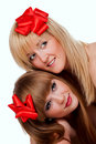 Two smiling young women with gift red bow Stock Photo