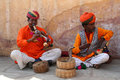 Two snake charmers performing on the street in jaipur in rajasthan india Royalty Free Stock Photography