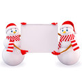Two snow man carrying white sign Royalty Free Stock Image