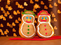 Two snowman shaped Christmas cookies Royalty Free Stock Images