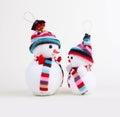 Two Snowman On White