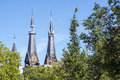 Two spires in the sunlight in Amsterdam Royalty Free Stock Photo