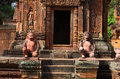 Two spirit guardians protecting entrance to Angkor Royalty Free Stock Photo