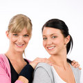 Two sport woman friends hugging smiling Stock Photos
