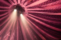 Two spotlights on fame shining down under a red stripey circus tent Royalty Free Stock Images