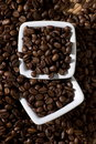 Two square bowls with coffee beans Stock Photo