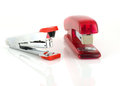 Two staplers on white background Stock Image