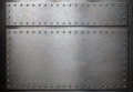 Two steel plates with rivets over metal background Royalty Free Stock Photo