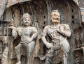 Two stone buddhist statues Royalty Free Stock Photo