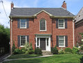 Two story brick house Royalty Free Stock Photo