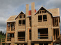 Two story townhouses under construction on a cloudy day Stock Photography