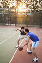 Two street basketball players on the basketball court Royalty Free Stock Photography