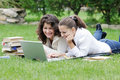 Two student girls with laptop Royalty Free Stock Images