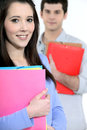 Two students carrying folders Stock Photos