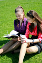 Two students relaxing on the grass Stock Image