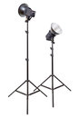 Two studio flash light monoblocks on tripods isolated white background Stock Photo