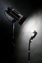Two studio flashes lightening a black background Royalty Free Stock Image