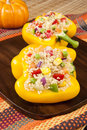 Two stuffed yellow peppers for thanksgiving dish of with quinoa Stock Photo