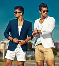 two stylish confident handsome men in the street Royalty Free Stock Photo