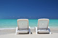 Two sunbeds overlooking atlantic exuma bahamas Stock Photos