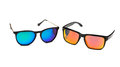 Two sunglasses, blue and yellow lens. Royalty Free Stock Photo