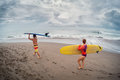 Two surfers walking with surf boards Royalty Free Stock Photo