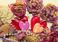 Two sweet hearts and dry flowers over white bacground Royalty Free Stock Photo
