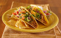 Two tacos with salsa and sour cream Royalty Free Stock Image