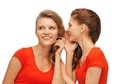 Two talking teenage girls in red t shirts picture of Stock Photo